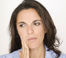 a woman with severe toothache